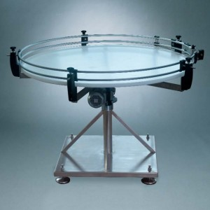 Motorized rotating table with plastic disc and stainless steel support base
